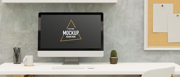 Computermonitor mit mockup-bildschirm auf dem schreibtisch im loft-büroraum