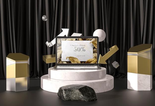 Digitales tablet mit goldenen blättern auf treppen