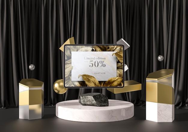 Digitales tablet mit goldenen blättern und geometrischen formen