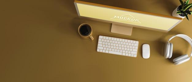 Draufsicht gelbes arbeitsplatzdesign gelber computer auf gelbem schreibtisch mit kopienraum