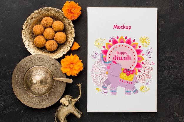 Draufsicht glückliches diwali festivalmodell mit süßigkeiten