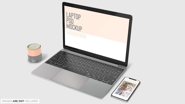 Draufsicht macbook pro und iphone x mit dekoration führt psd-modell einzeln auf
