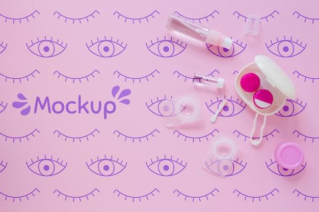 Draufsichtoptik-stilllebenanordnung auf rosa hintergrundmodell