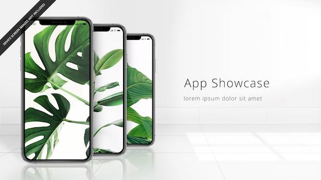 Drei pixel perfektes iphone xs auf einem mit ziegeln gedeckten reflektierenden boden, uhd-modell