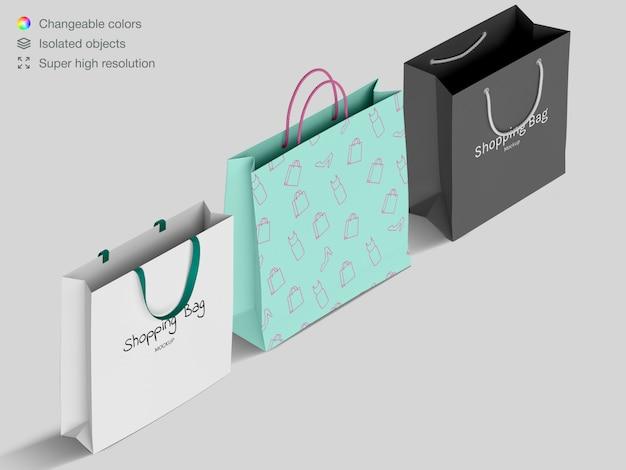 Drei realistische isometrische einkaufspapiertüten-modellschablone