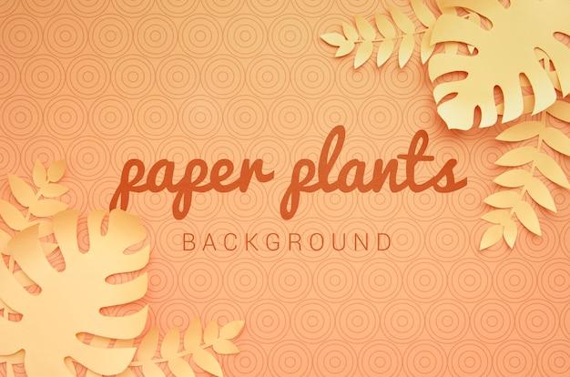 Einfarbiger orange hintergrund der papierpflanzen