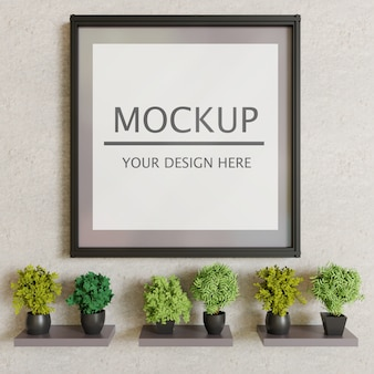 Einzelbildmodell auf gipswand mit dekorationspflanzen