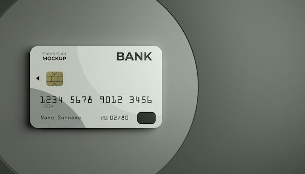 Einzelnes kreditkartenmodell mit bühnenhintergrund.
