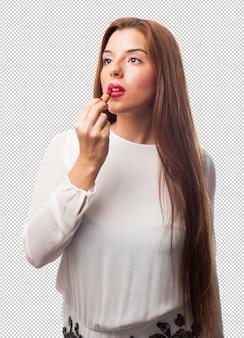 Elegante frau, die einen lippenstift verwendet