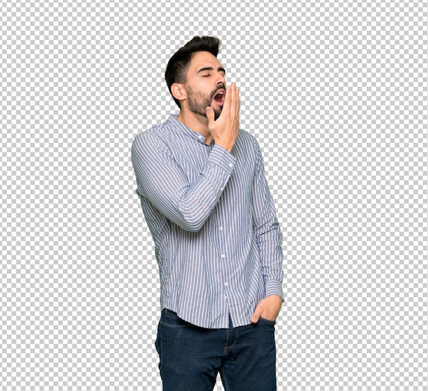 Eleganter mann mit dem gähnenden hemd und weitem offenem mund mit der hand bedeckend