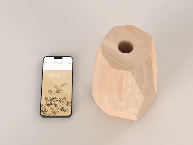 Elegantes arrangement mit mock-up-smartphone und vase