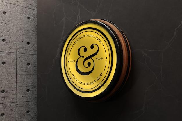 Elegantes logo-modell auf betonwand
