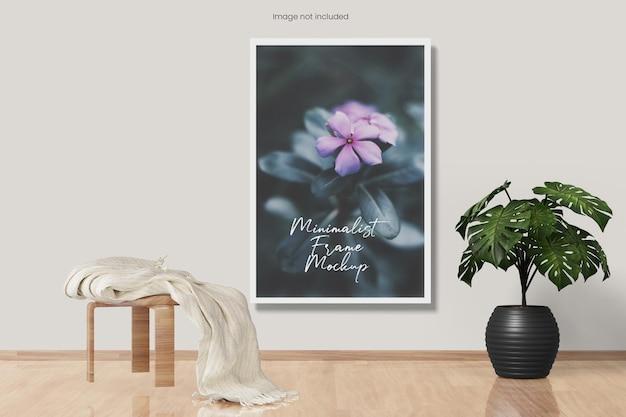 Elegantes minimalistisches fotorahmenmodell, das an der wand hängt hanging