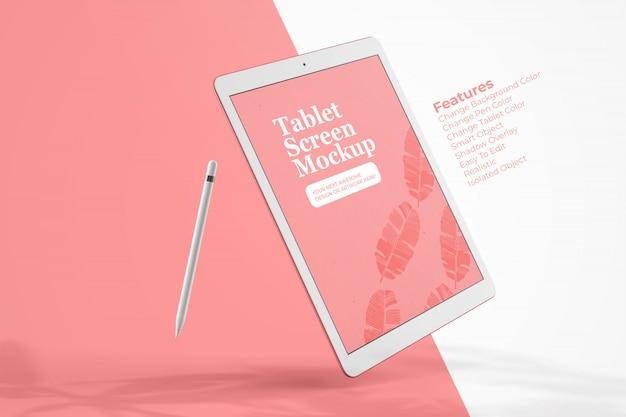 Elegantes tablet-modell, das mit digitalem bleistift schwimmt
