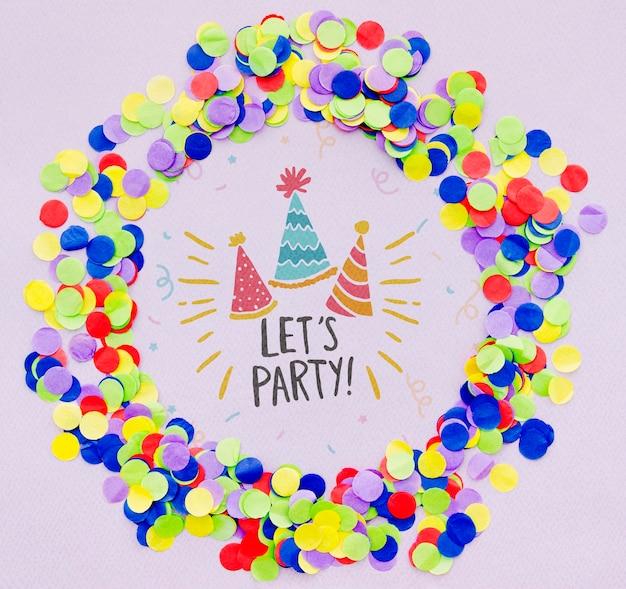 Feiern wir mit partyhüten und bunten konfetti