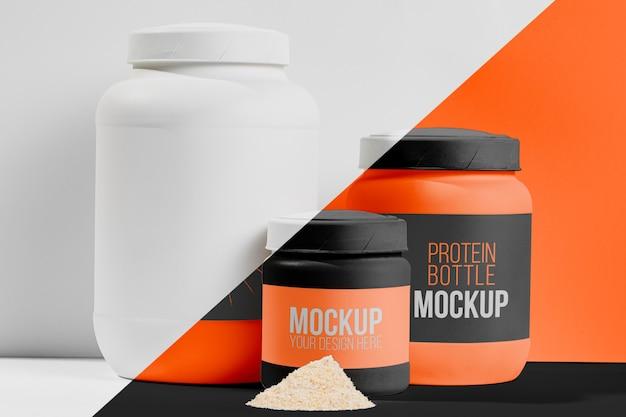 Fitness-stimulanzien in orangefarbenen behältern