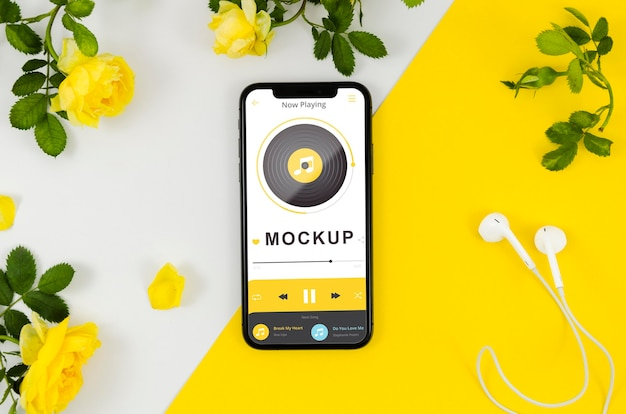 Flaches smartphone-modell mit blumen
