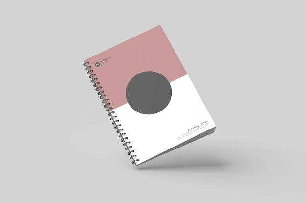 Flying spiral notebook mockup design isoliert