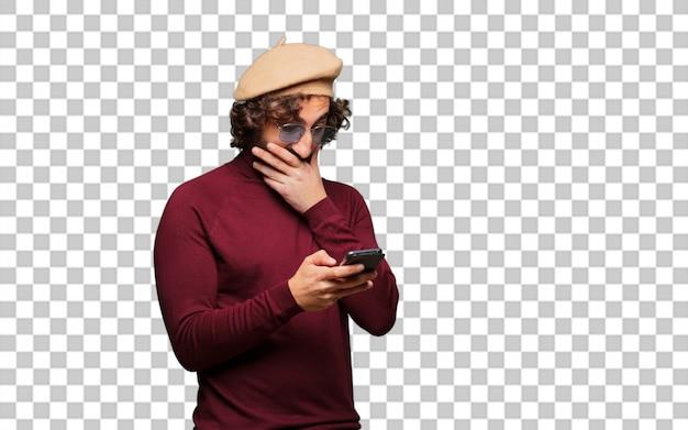 Französischer künstler mit barett und mobiltelefon