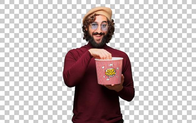 Französischer künstler mit einem barett, der popcorneimer hält