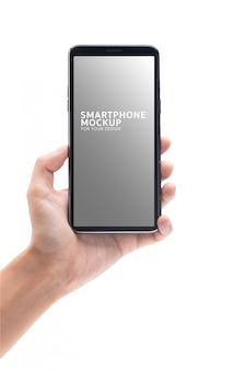 Frauenhand, die das schwarze smartphonemodell für ihr design hält.