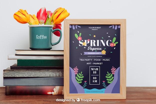 Frühlingsmodell mit rahmen nahe bei büchern