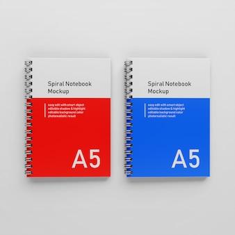 Gebrauchsfertig zwei bussiness hard cover spiral a5 binder notizblock mockups design-vorlagen nebeneinander in der draufsicht