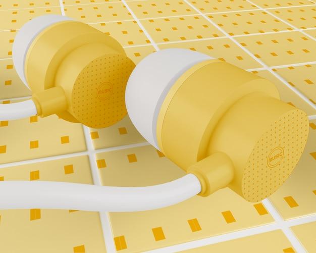 Gelbe kopfhörer mit weißem kabel