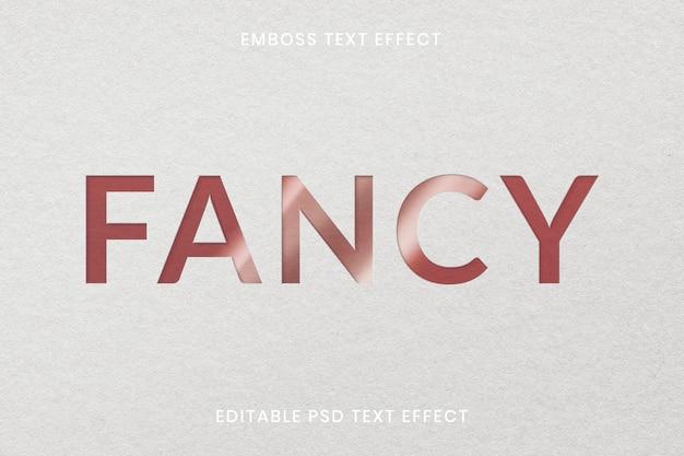 Geprägte texteffekt-psd-bearbeitbare vorlage auf weißem papiertexturhintergrund