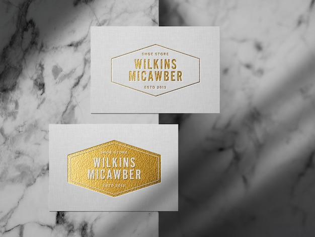 Geprägtes goldenes logo-modell auf leinenpapier