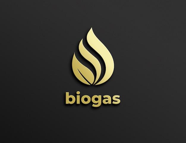 Geprägtes goldenes logo-modell auf schwarzer wand