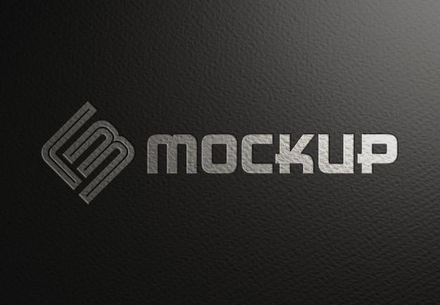 Geprägtes logo-modell auf schwarzer papierstruktur