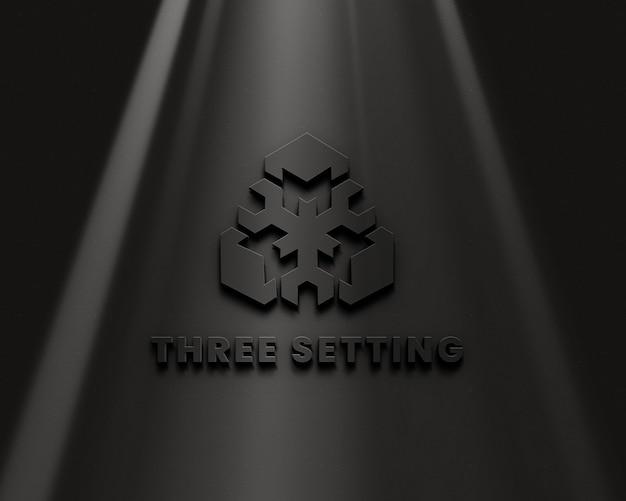Geprägtes logomodell auf schwarzer wand premium psd