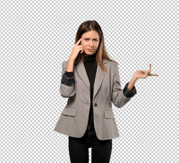 Geschäftsfrau, welche die geste des wahnsinns finger auf den kopf setzt