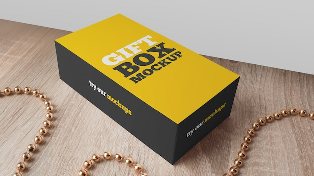 Geschenkbox-modell auf holztisch
