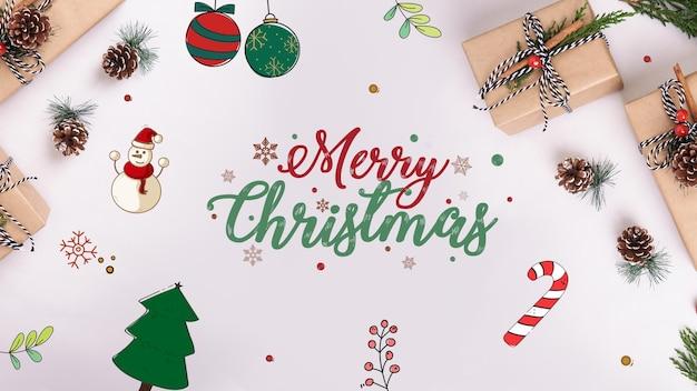Geschenkboxen und ornamente auf dem tisch zu weihnachten