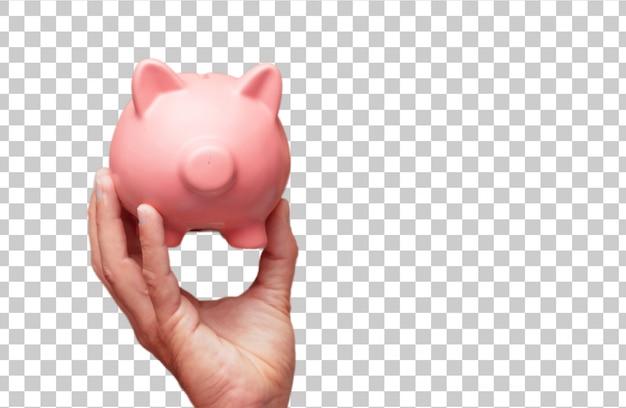 Getrennte männliche hand, die ein sparschwein hält