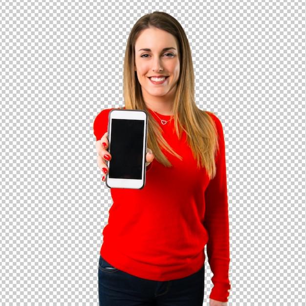 Glückliche junge blonde frau, die mit mobile spricht