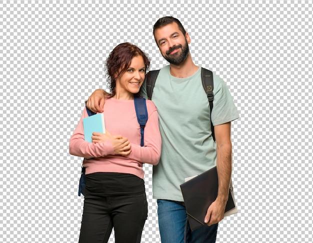Glückliche zwei studenten mit rucksäcken und büchern