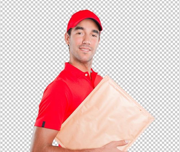 Glücklicher lieferer, der ein paket liefert