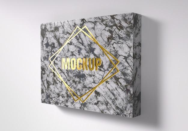 Gold-logo-modell auf marmor