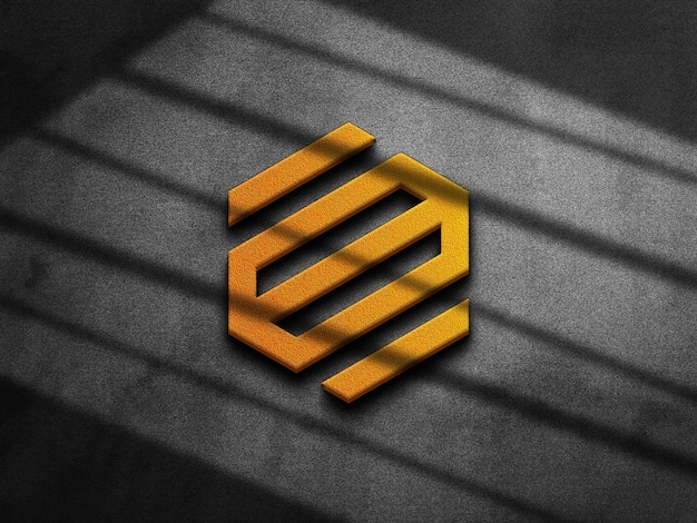 Goldenes logo-modell 3d auf konkreter beschaffenheit