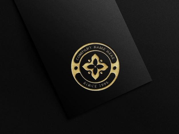 Goldfarbenes logomodell mit prägeeffekt