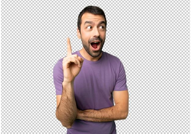 Gut aussehender mann, der eine idee den finger oben zeigend denkt