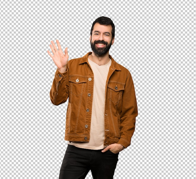 Gut aussehender mann mit bart begrüßend mit der hand mit glücklichem ausdruck