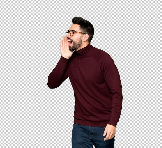 Gut aussehender mann mit brille schreien mit weit offenem mund zur seite