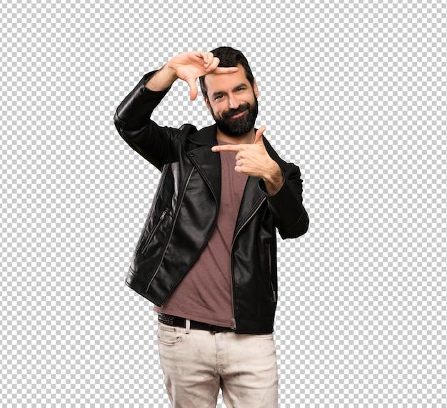 Gut aussehender mann mit dem bart, der gesicht fokussiert. rahmensymbol