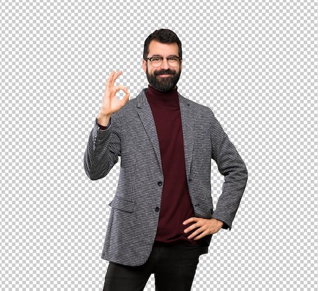 Gut aussehender mann mit den gläsern, die okayzeichen mit den fingern zeigen