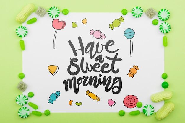 Haben sie einen süßen morgen mit köstlichem süßigkeitsrahmen
