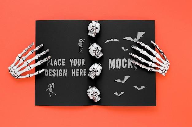 Halloween-arrangement mit skeletthänden